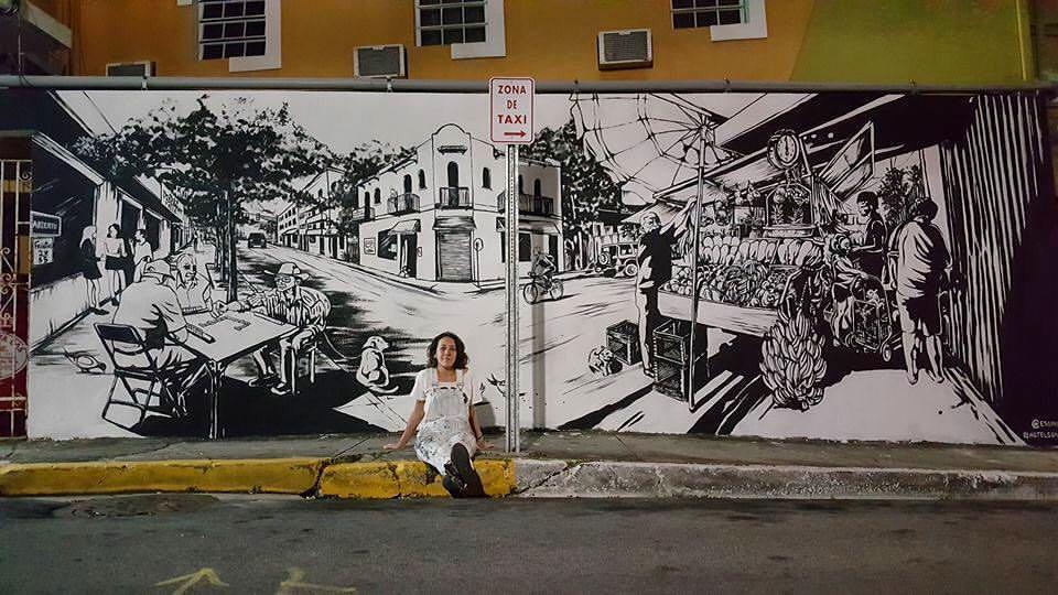 Artist Sarah Urbain  mural with local street scenes.