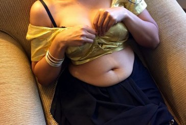 Indian housewife stripping off saree blouse posing in bra petticoat