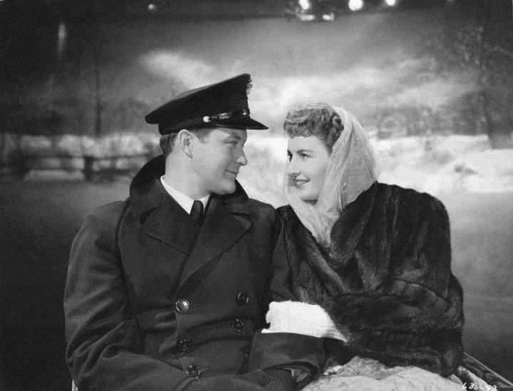 Movie still of couple riding in sleigh during snowfall