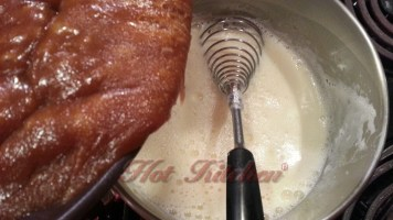 After tempering the hot milk into the eggs, add the brown sugar - butter mix that has cooled slightly.
