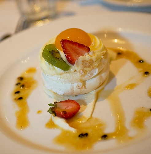 Fresh Fruit Pavlova with Passionfruit Coulis