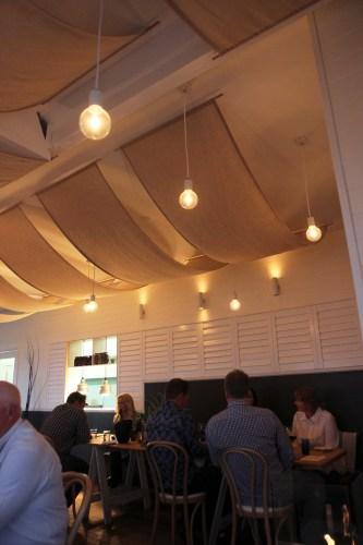 Billowing sails and retro bulbed lighting