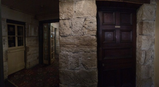 The sandstone walls inside the Inn