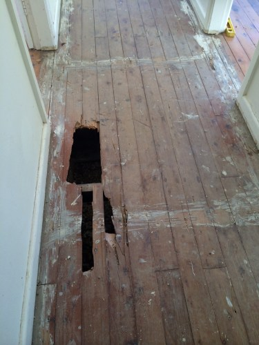 The tiles were taken up off the floor but left a few holes!