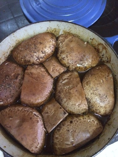 Placing the portobello mushrooms onto the sauce