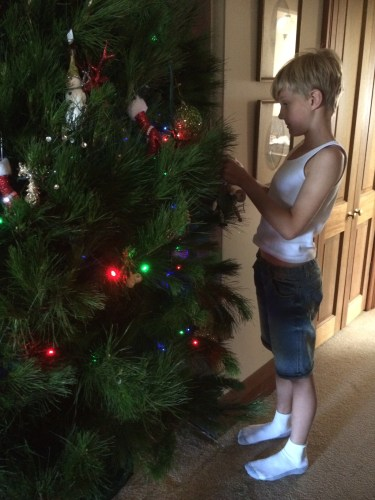Helping me decorate the tree