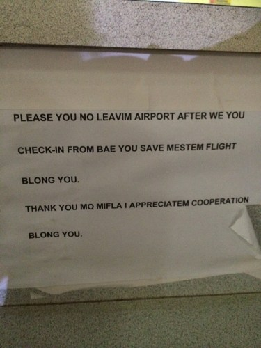 Sign at the check-in counter