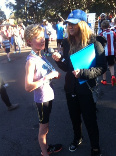 Being interviewed after finishing the 5km