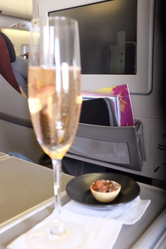 Glass of champagne with an antipasto tart