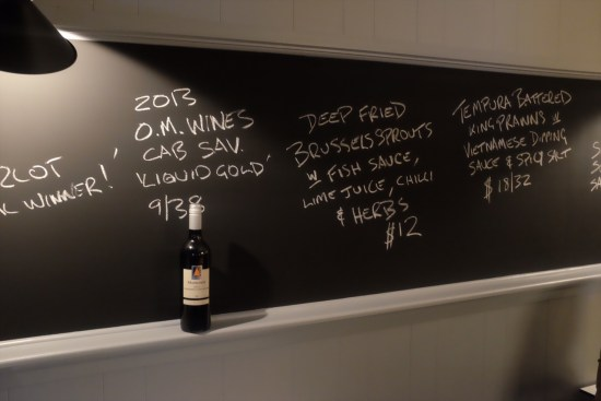 Old-school styled blackboard with a shelf to house your wine