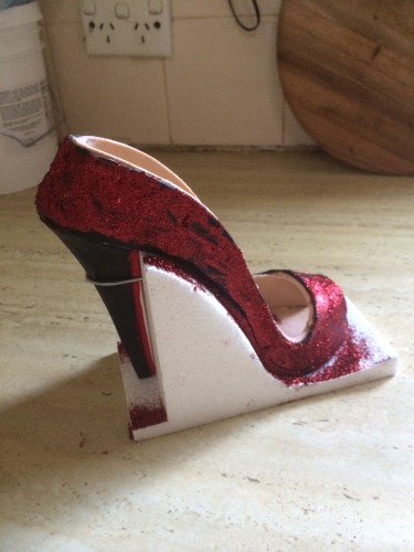 A shoe covered in glitter