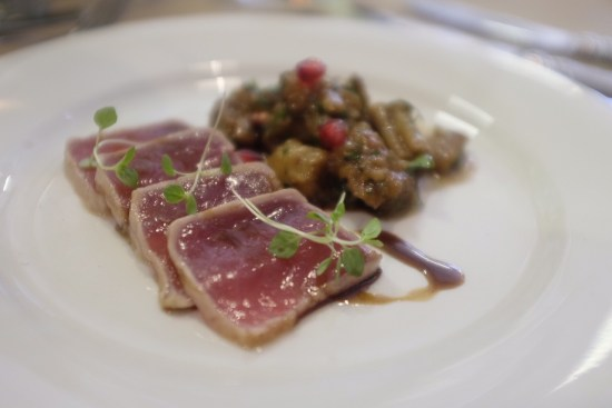 Grilled tuna loin, sweet and sour eggplant and pomegranate relish