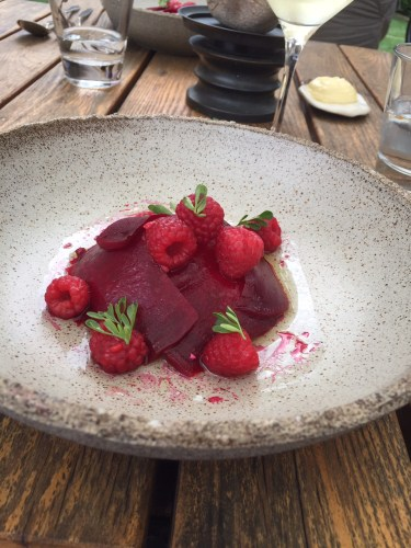 Sheep's milk curd with lightly pickled raspberries and beetroots bloomed in their own juices