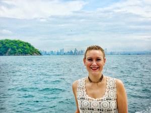 Girl on boat with Panama City Skyline
