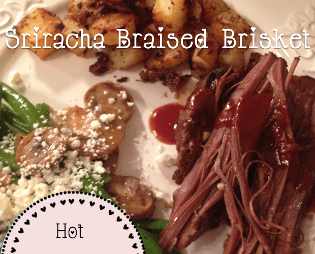 Sriracha braised brisket on a plate with green beans topped with mushrooms and feta cheese, and roasted potatoes.