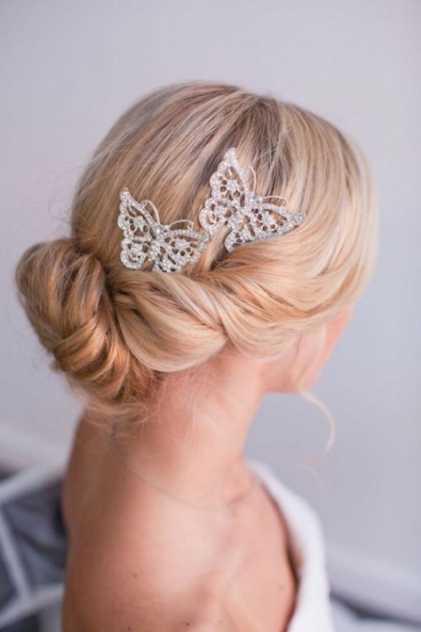 Beach Wedding Updo with Butterfly Accessory