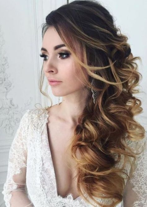 Large Curly Side Swept Hairstyle
