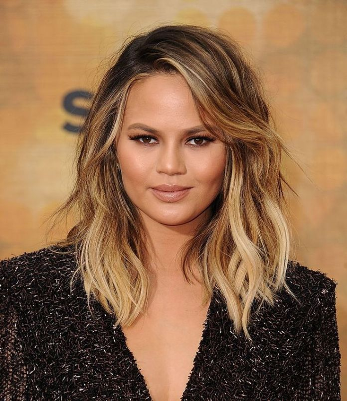 Blonde Wavy Hair with Choppy Ends