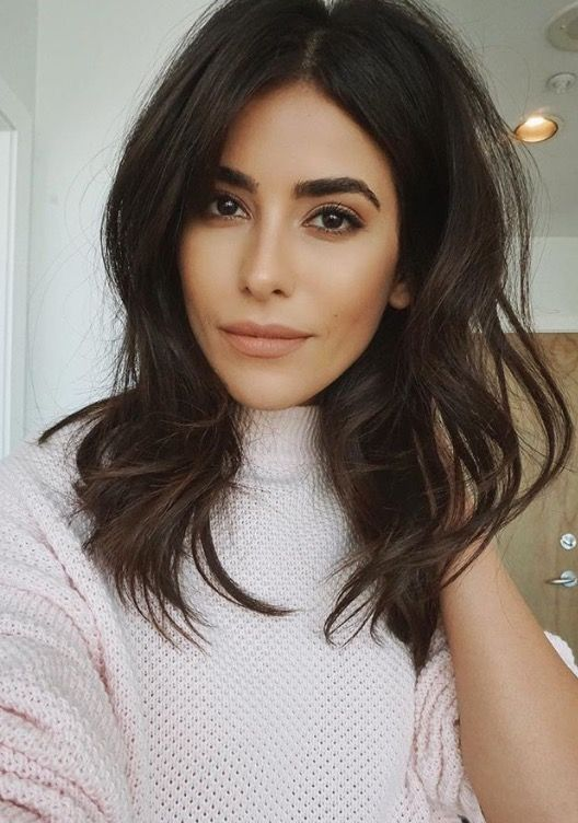 Middle Parted Medium Wavy Hairstyle