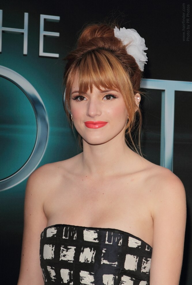 Bella Thorne Hairstyle With High Bun Decorated With Flower