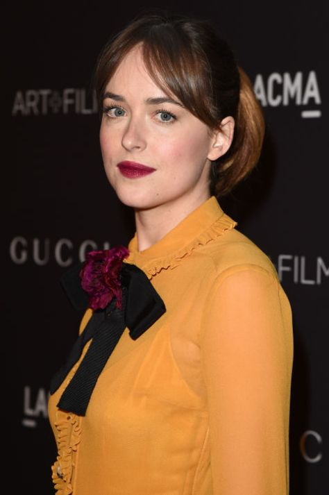 Dakota Johnson Vintage Touch Hairstyle With Bangs