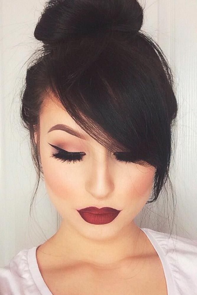 Flattering Updo With Side Swept Bangs