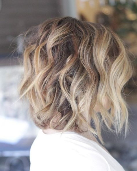 Curly Messy Bob with Blonde Highlights