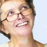 15 Hairstyles for Women Over 50 With Glasses