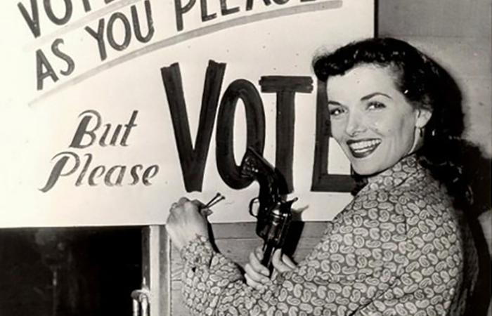 Woman with gun urges you to vote