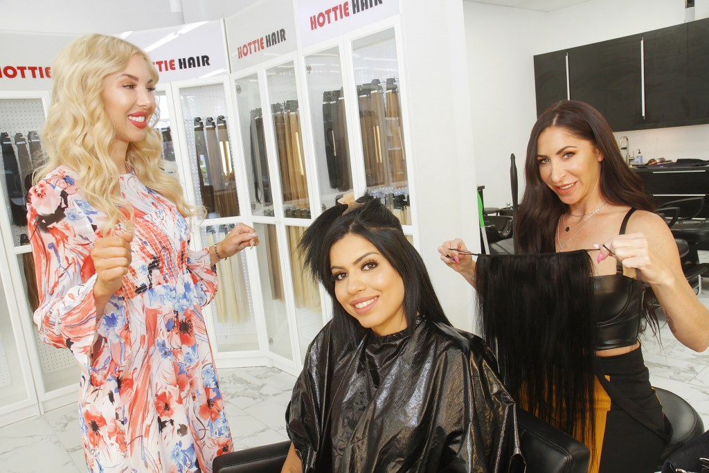 Women Trying On Clip In Hair Extensions In Las Vegas as Hottie Hair Store and Hair Salon Las Vegas
