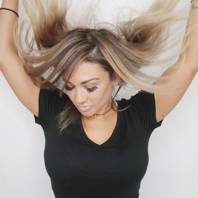 Women Showing Off Her Brand New Hair Extensions That She Had Installed In Las Vegas