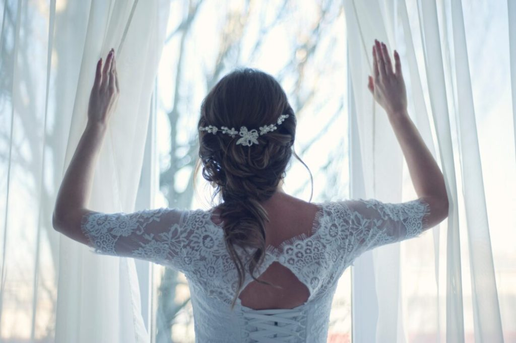 women bridal bride brunette wearing hair extensions looking out window
