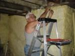 Al working on plumbing