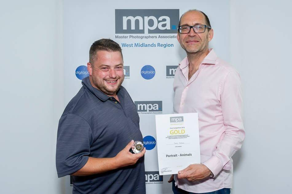 Jamie Morgan LMPA and Richard Bradbury FMPA Photographed receiving the Gold Award in the MPA Regional Print Competition.