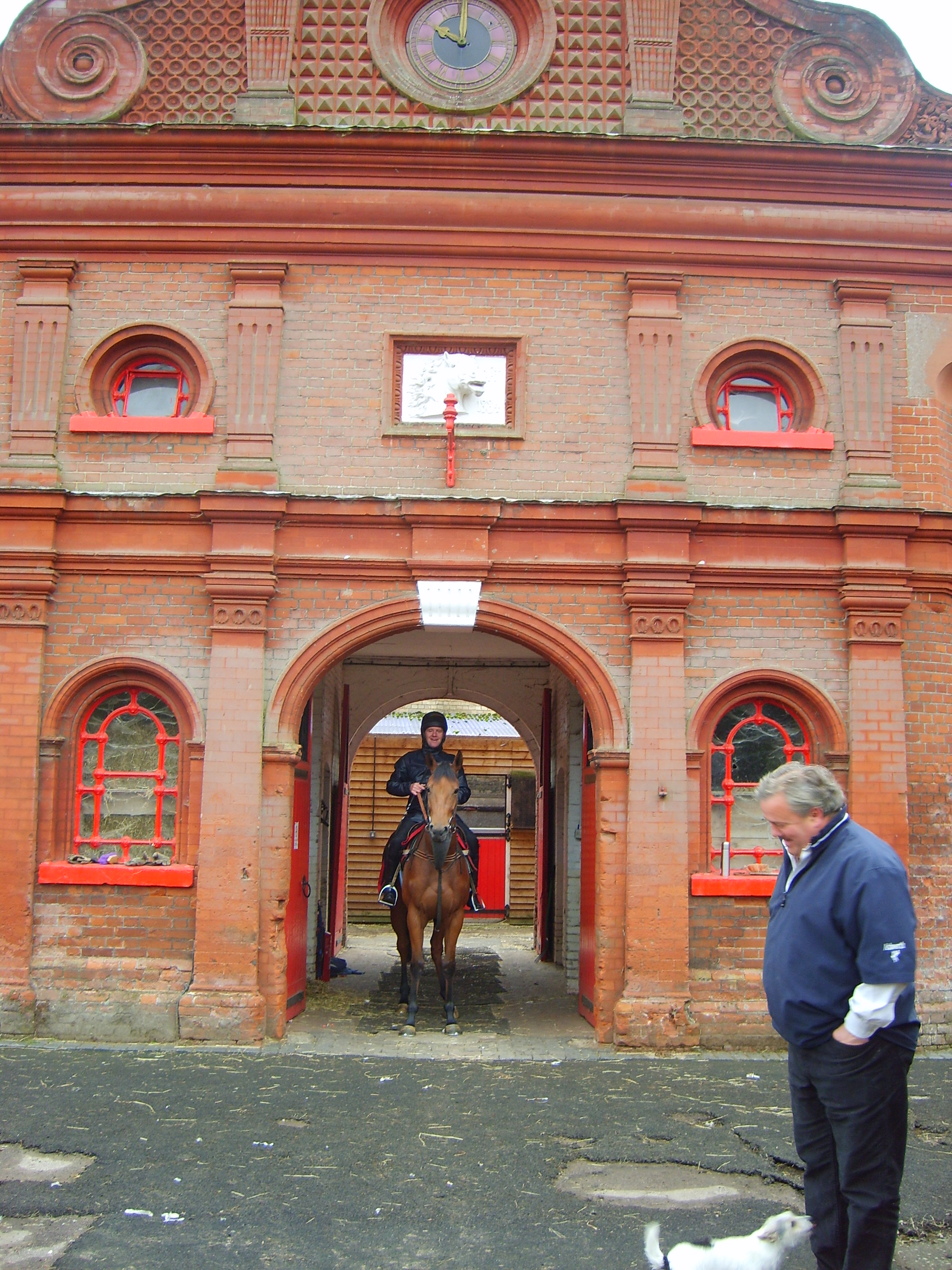 Peter Chapple-Hyam and his terrier at his yard, Newmarket's oldest working stable yard.