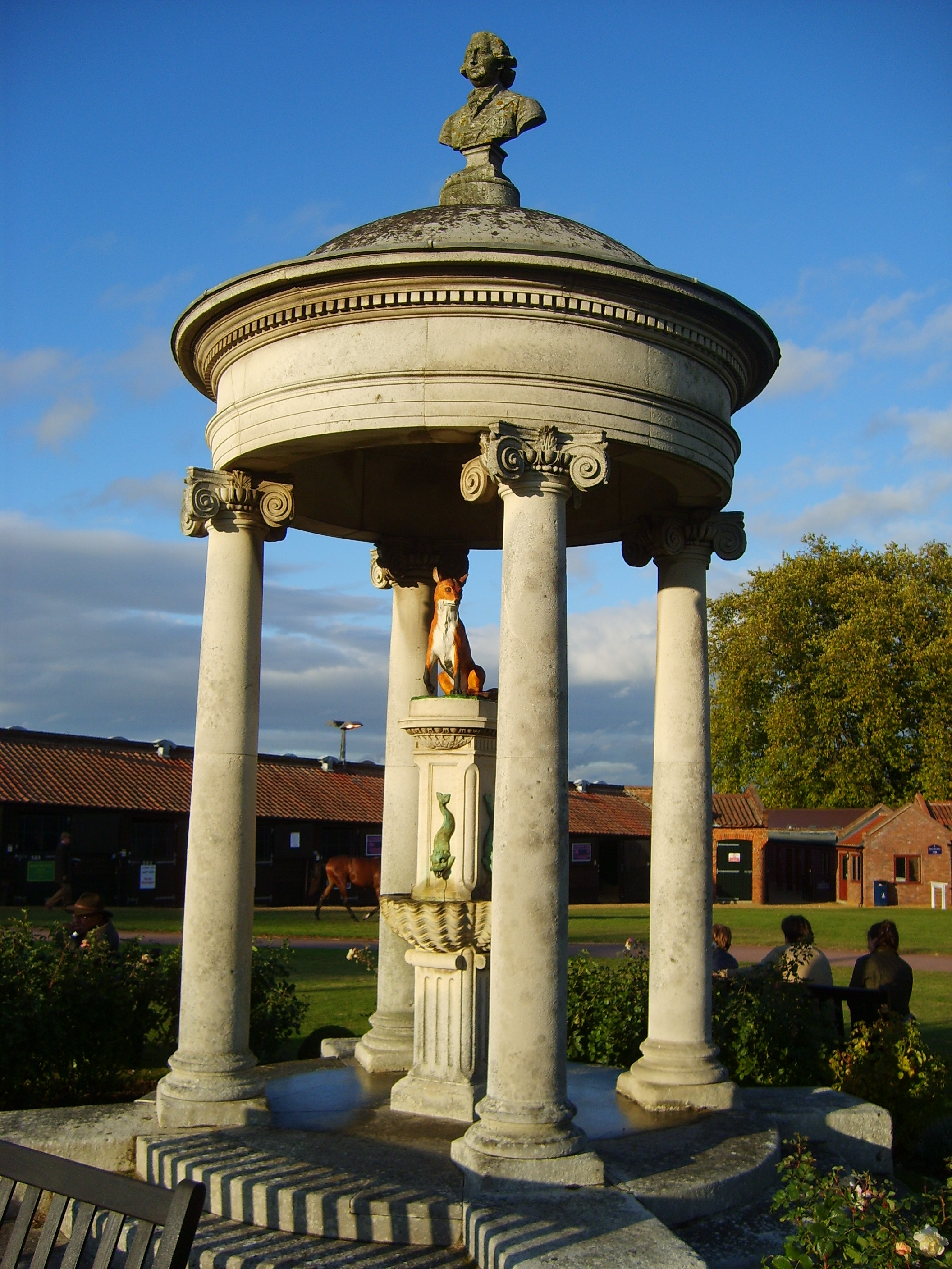 The Tattersalls auction house in England is the world's oldest Thoroughbred sales company and has a long association with foxhunting, as evidenced by the fox seen sitting in the iconic Tattersalls cupola. The structure, known simply as The Fox, is topped by a bust of King George IV. The Fox is a covered fountain that used to serve as a water trough at the company's original location on Hyde Park Corner in London.