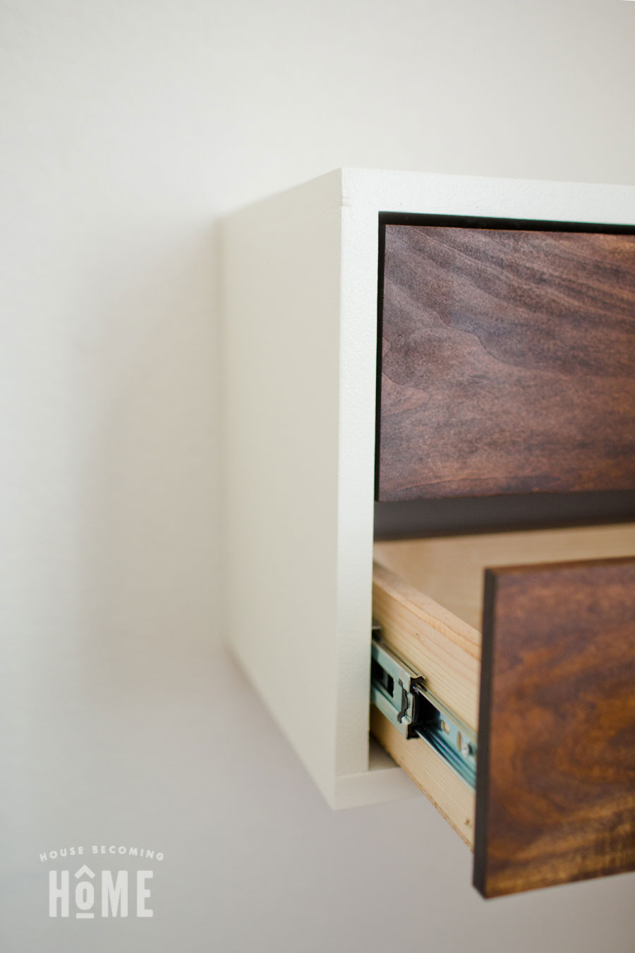 How to Build a Simple DIY Floating Nightstand with Drawers. Includes free printable pdf plans.
