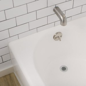 DIY Bathtub Refinish. Paint an almond bathtub white with an affordable refinishing kit.