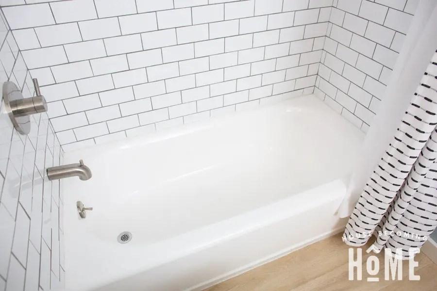 almond bathtub with white tub