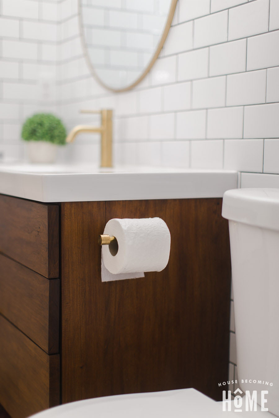 Finished Brass Toilet Paper Holder Mounted to Vanity