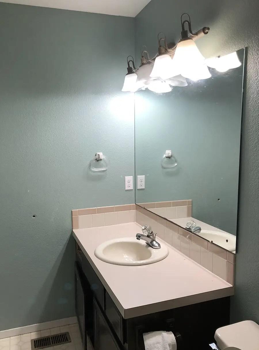 Small Bathroom Renovation Before: Builder Grade Bathroom sink and countertop