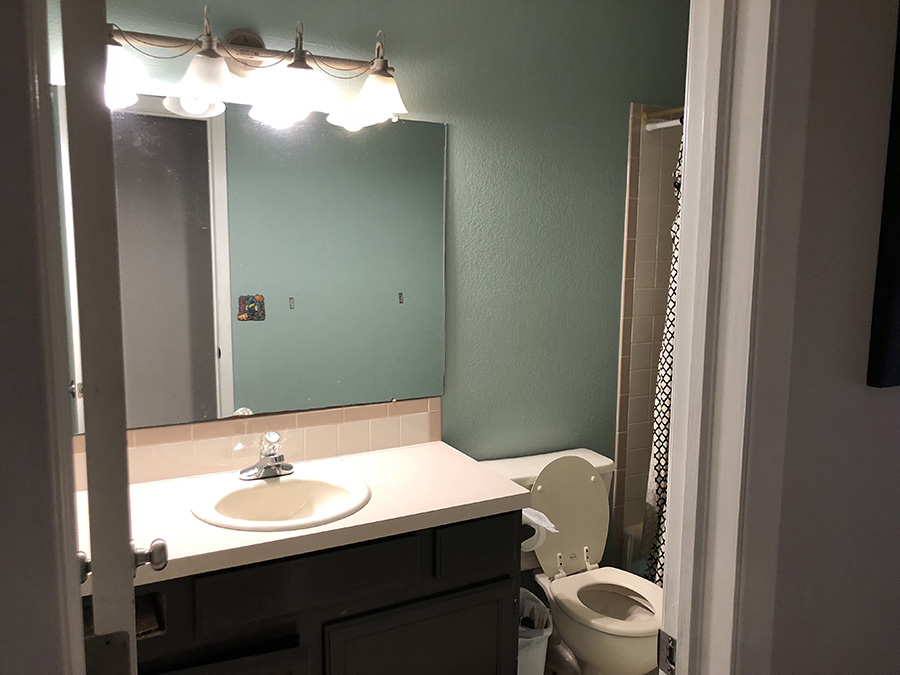 Full view of small bathroom before renovation