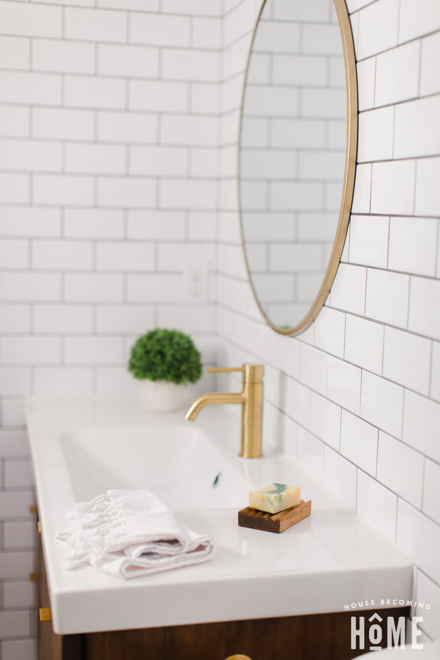 Small Bathroom Renovation After Shot on House Becoming Home : floating wood vanity, white subway tile, brass faucet and white countertop