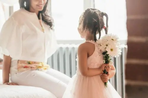 Daughter-about-to-suprise-mom-with-flowers