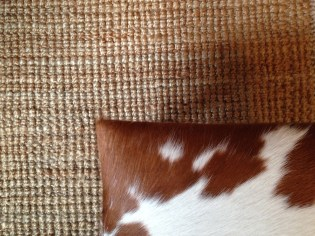 sisal rug with cowhide foot stool