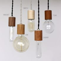 Wood veneered pendant light. USD $45 each.