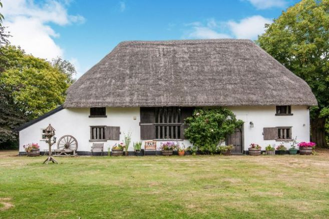 Thatched roof historic UK cottage