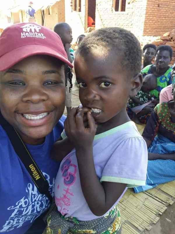 Natasha Nicholes  from Houseful of Nicholes with one of the young ladies from the Salima, Malawi village.