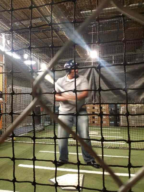 Taking a swing in the batting cages at Louisville Slugger Museum and Factory