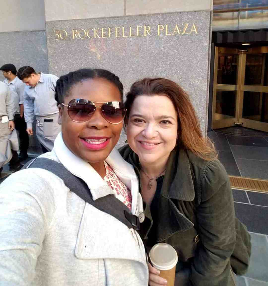 Natasha Nicholes from Houseful of Nicholes and Laurie White from Mom 2.0 standing in front of Rockefeller Plaza in New York City